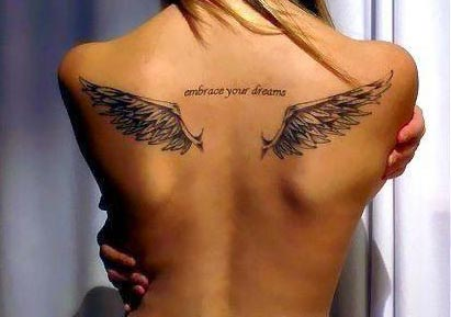 Angel Wings On Upper Back Tattoo
