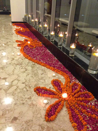Small Rangoli Designs With Flowers For Entrance Corner
